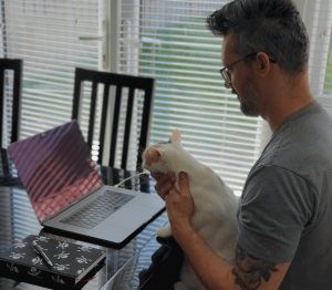 Employee working from home with pet cat